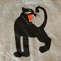 Grå melerad jumpsuit med en svart panter på bröstet från Mini Rodini stl 80-86