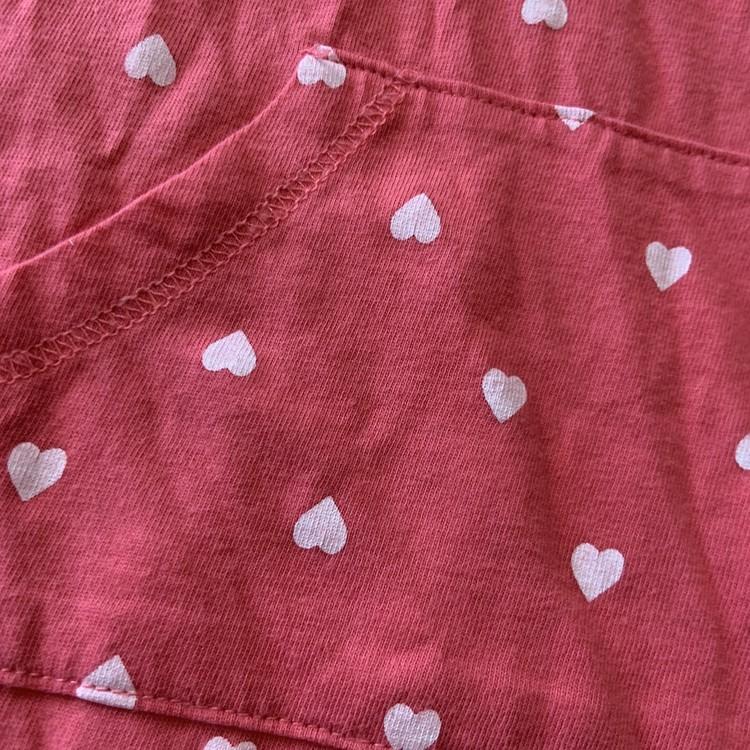 Rosa jumpsuit med vita hjärtan från HM stl 68