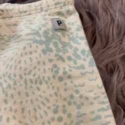 Vita leggings med turkosa fläckar från PoP stl 62