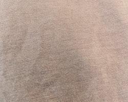 Lila body med hålbroderad volangärm från Newbie stl 62