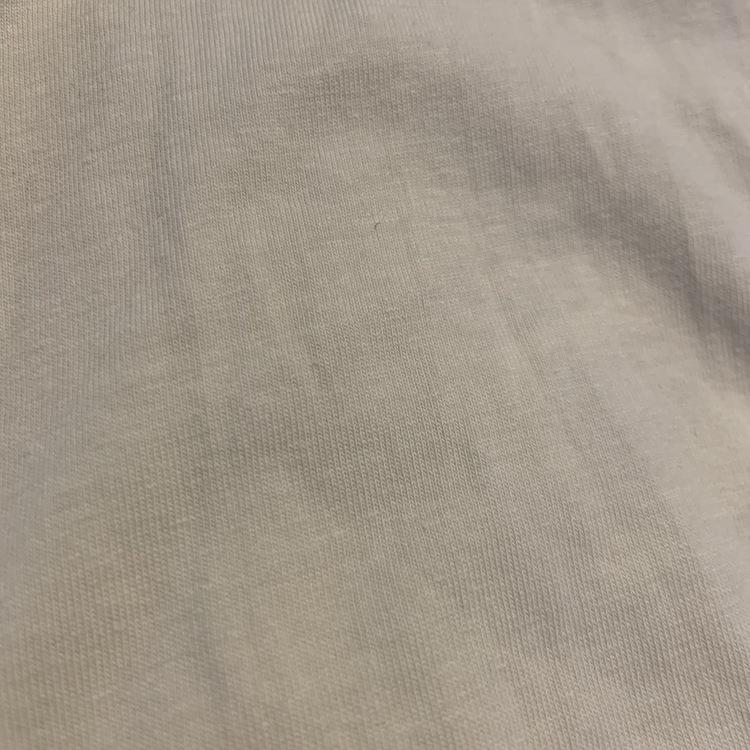 Ljusgul body med hålbroderade volangärmar och matchande volangleggings från Newbie stl 62