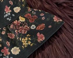 Mörkblå klänning med flerfärgat blommönster från Lindex stl 74