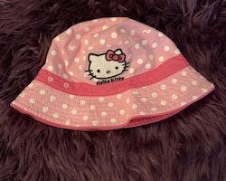 Vändbar solhatt i rosa, ljusrosa och vitt med Hello Kitty från Sanrio stl 9-18 mån