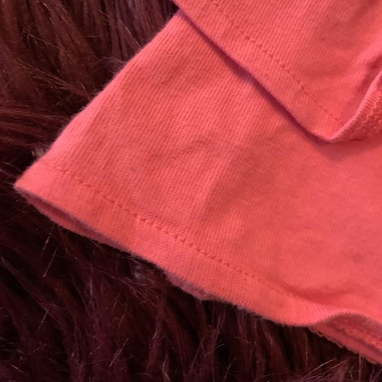 Rosa linne med volanger och blomsterbroderi från Kappahl stl 80