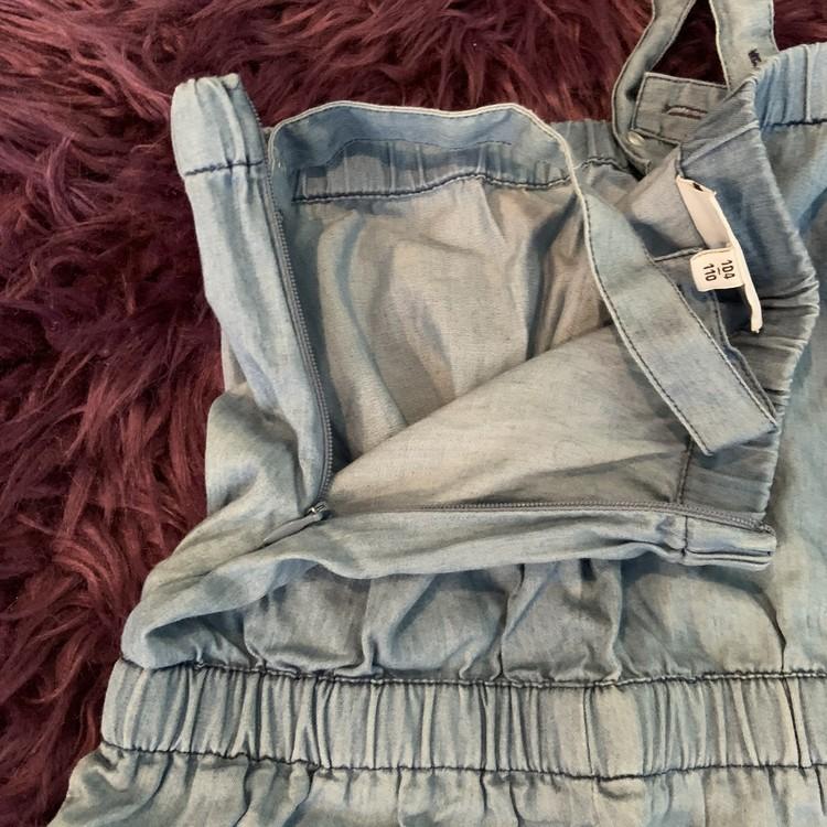 Ljusblå jumpsuit från Mini Rodini stl 104/110