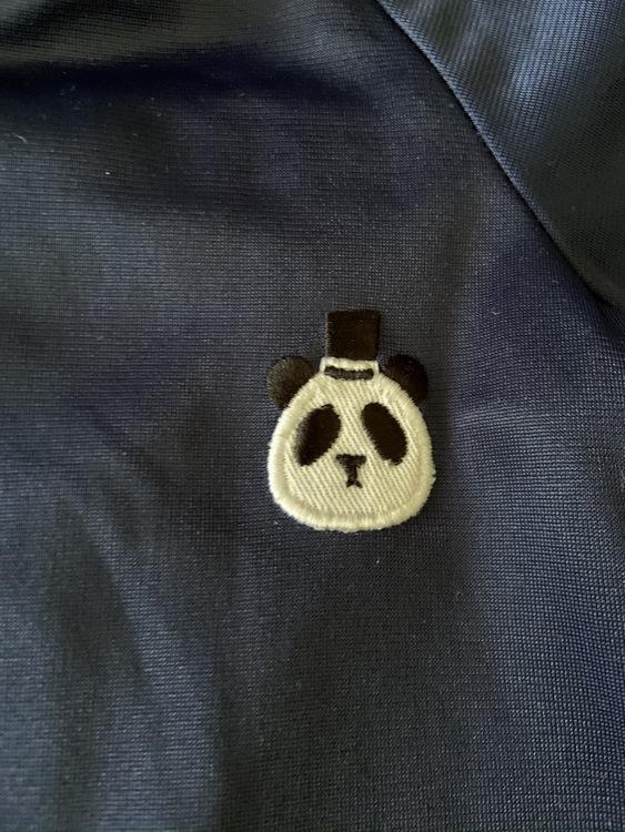 Mörkblå träningsoverall med liten panda applikation från Mini Rodini stl 80/86