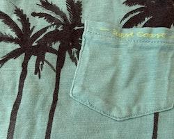 Grönturkos t-shirt med mörkgrå palmtryck från Zara stl 116