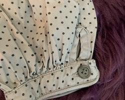 Grålila byxor med mörkgrå prickar från Norlie stl 74