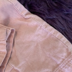 Rosa manchester hängselbyxor med volanger från PoP stl 74