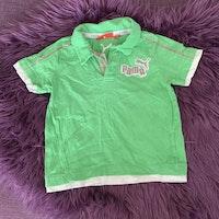 Grön piké med vita och grå detaljer från Puma stl 92