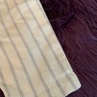 Off white byxor med tunna ljusblå ränder och fickor från Mini A Ture stl 74