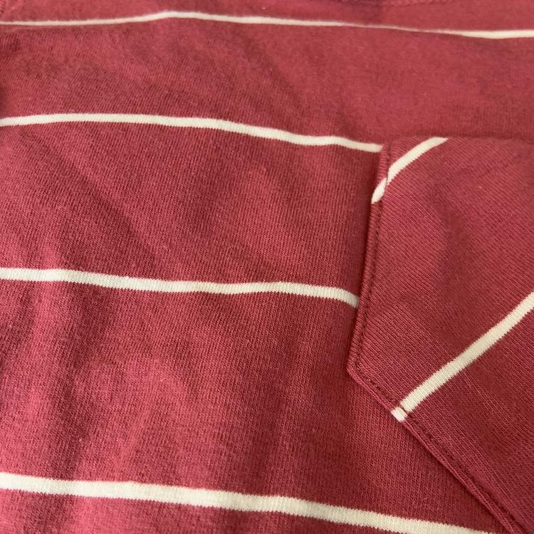 Tredelat set i rostrött med vita ränder bestående av en body och två par leggings från Ebbe stl 62