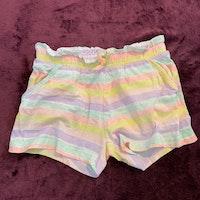 Randiga shorts i rosa, gult, lila och turkost från HM stl 98/104