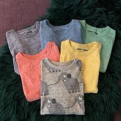 6 delat tröjpaket med fem melerade enfärgade och en med elefanter från NeXT stl 86