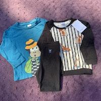 3 delat paket med två tröjor och ett par leggings i svart, petrol och beige med djurmönster från PoP stl 86 + 92