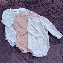 3 delat bodypaket i främst rosa och vitt från Lindex stl 56
