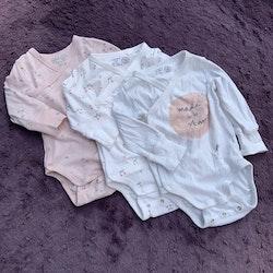 3 delat paket med omlottbodies i vitt och rosa med körsbär, blommor och kaniner från Lindex stl 56