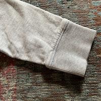 Grå collegetröja med ficka på magen från Lindex stl 68