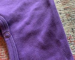 Lila jumpsuit/onesie med en blå elefantapplikation från Lipfish stl 68