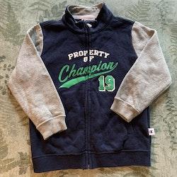 Gråmelerat och mörkblått collegeset med tröja och byxa från Champion stl 92