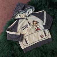 Set med bya och tröja i ljus- och mörkblått samt Musse Pigg detaljer från Disney & Kappahl stl 86