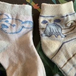 4 delat paket strumpor i blått och vitt med ränder och djur stl 19-21