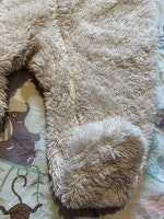 Cremefärgad overall i pile med öron och svans från HM stl 56
