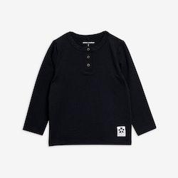 Svart tröja med farfarsknäppning från Mini Rodini stl 104/110