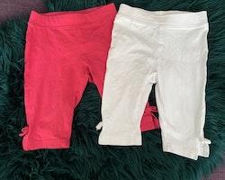 Två par 3/4 leggings i vitt och mörkrosa med rosetter från HM stl 86