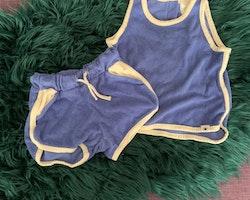 Linne och shorts set i blå frotté med vita kantband från Lindex stl 74