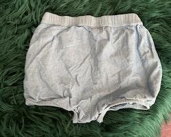 Blå bloomers/shorts från HM stl 92