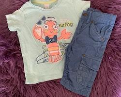 T-shirt och shorts i blått med en hummer från Baby club och HM stl 92