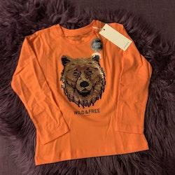 Orange tröja med björnmönster med vändbara paljetter från Tom Tailor stl 104/110