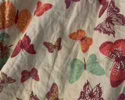 Ärmlös sommarklänning med färgglada fjärilar från HM stl 110