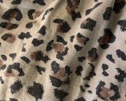 Ljusbrun ärmlös sommarklänning med leopardfläckar från HM stl 98/104