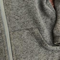 Mörkblå/svartmelerad stickad fleecejacka från PoP stl 110/116