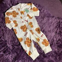 Vit pyjamas med lussekatter och karameller från Lindex stl 56