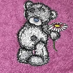 Nalle med blomma