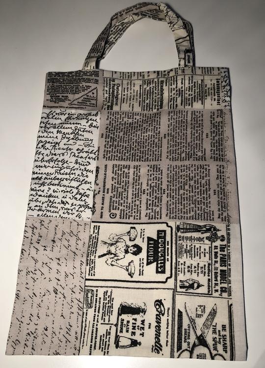 Tyg med tidnings-tryck