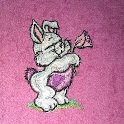 Kanin med blomma