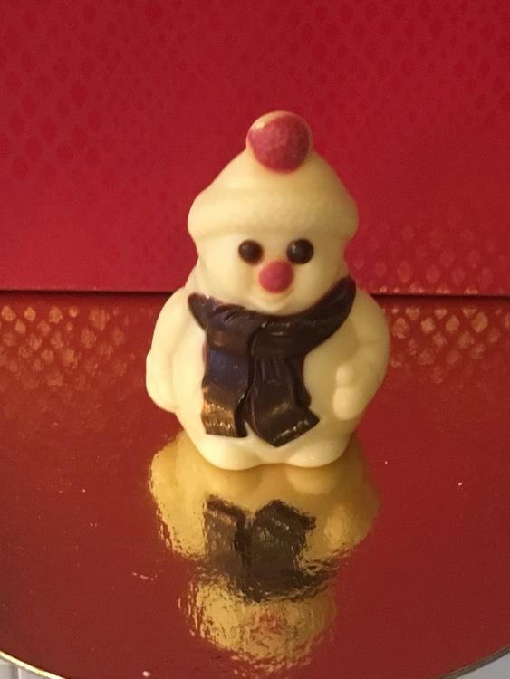 Snögubbe i vit choklad (Ligger förpackade enstycks i plastemballage)