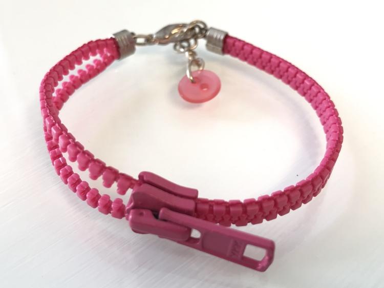 Dragkedjearmband - rosa