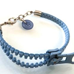 Dragkedjearmband ljusblått