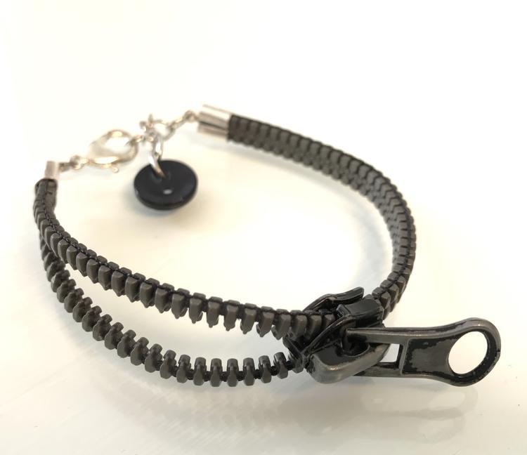 Dragkedjearmband-mörkgrått