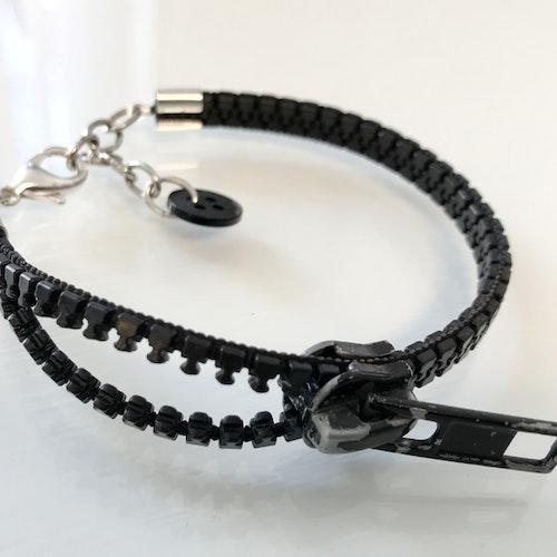 Dragkedjearmband - svart