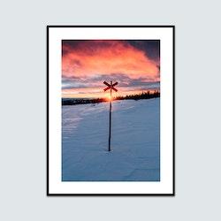 Solnedgång bakom ledkryss