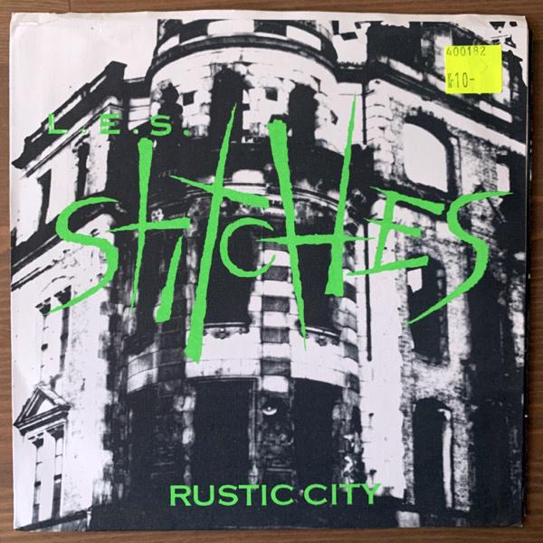 "L.E.S. STITCHES Rustic City (Green vinyl) (Honey Roasted - USA original) (VG+/EX) 7"""