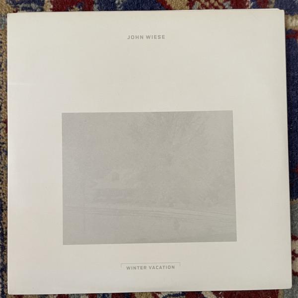 "JOHN WIESE Winter Vacation (White vinyl) (The Blue Sky Writings - USA original) (EX) 7"""
