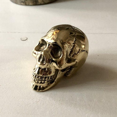 Döskalle guldfärgat brons
