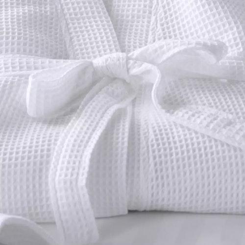 Vit badrock i våfflat mönster